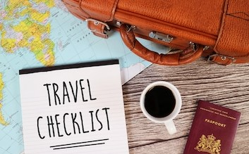 travel-checklist-suitcase-world-map-260nw-449655331